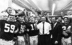 The Vikings celebrated a 37-13 victory over the Bears in their first regular-season game in 1961, surrounding two figures who would often clash — qu