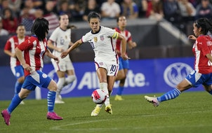 U.S. forward Carli Lloyd, center, dribbled past Paraguay midfielders Fanny Godoy, left, and Cynthia Ayala during the second half of an international f