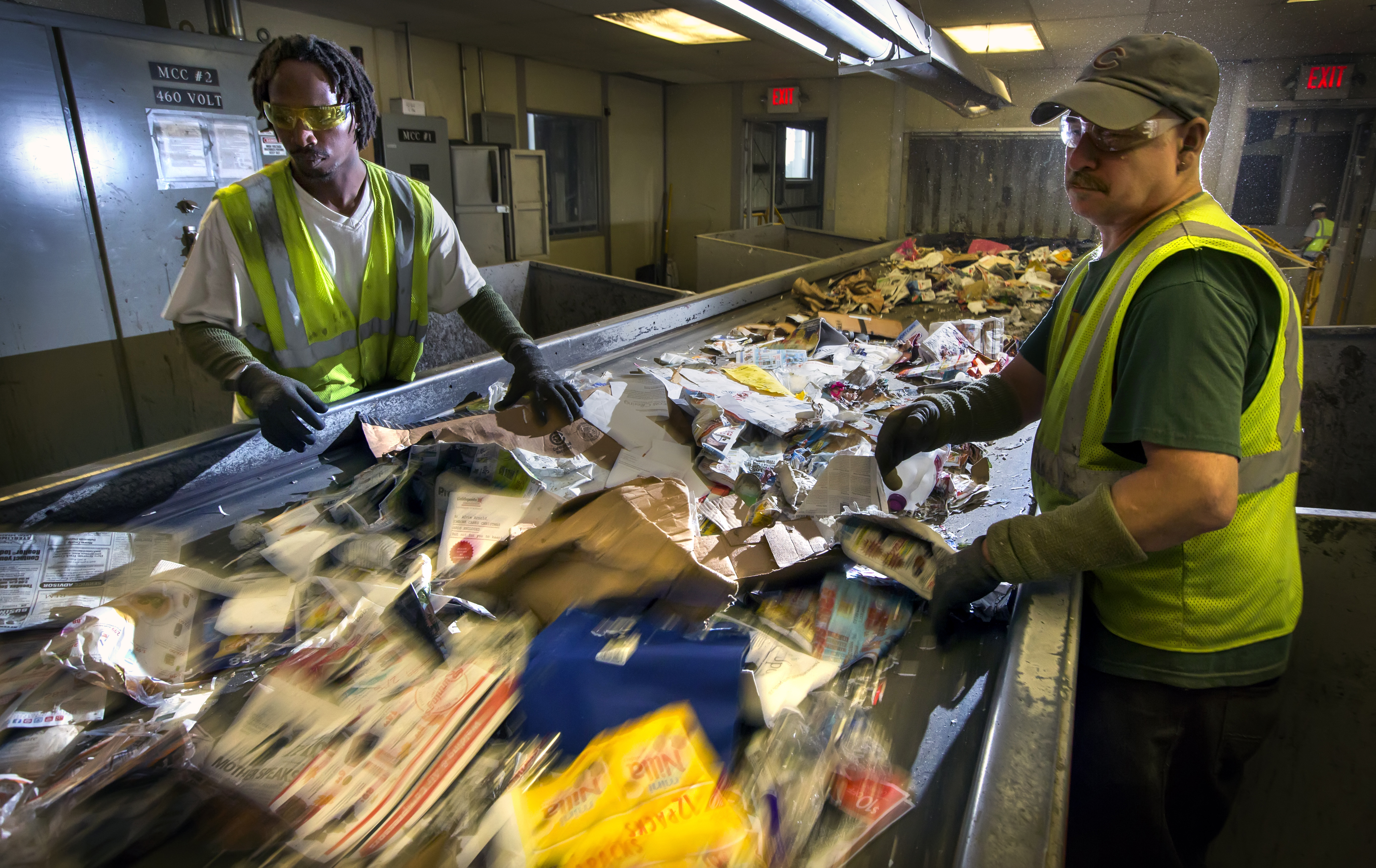 Workers on the sort line at Dem-Con's recycling facility in Shakopee in 2015.