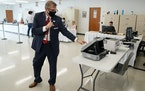 Minneapolis City Clerk Casey Carl looked over a new ballet marking device during a media tour of the early voting center Thursday. ] ANTHONY SOUFFLE �