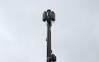 Antennas are affixed to a new cellular pole in south Minneapolis.