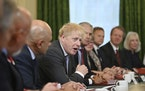 Britain's Prime Minister Boris Johnson, centre, speaks during the first Cabinet meeting since the reshuffle, at 10 Downing Street, in London, Friday