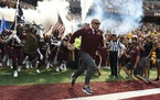 Minnesota head coach P.J. Fleck runs onto the field before their game against Miami-Ohio during an NCAA college football game on Saturday, Sept. 11, 2