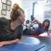 Nell Hurley, right, led Megan Vanderbilt through a strength training circuit at her in-home studio.