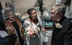 """, Marquetta Senters, Khamara Pettus and Kevin Kling enact a wedding scene in Mixed Blood Theatre's new play, """"Animate,"""" at the Como Zoo in St. P"""