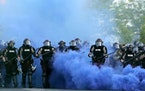 Minnesota State Police officers approach a crowd of protesters in Minneapolis on May 30, 2020. The Minnesota State Patrol purged e-mails and texts mes