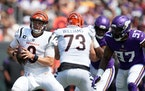 Cincinnati quarterback Joe Burrow scrambled away from Vikings defensive end Everson Griffen on Sunday.