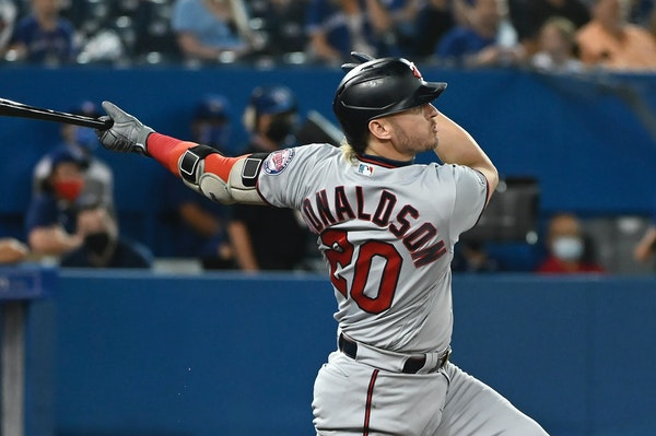Josh Donaldson follows through on a solo home run against the Blue Jays during the third inning Friday.