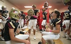 Lakeville South players got ready in the locker room before the game on Friday.