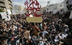 Supporters of Yemen's Shiite Houthi rebels chant slogans as they mark the holy day of Ashoura, in Sanaa, Yemen, Thursday, Aug. 19, 2021.