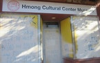 """Scrawled on white paint at the Hmong Cultural Center in St. Paul was """"Life, Liberty, Victory,"""" associated with white nationalists."""