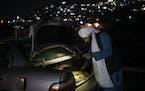A Taliban fighter checks the trunk of a car at a checkpoint in Kabul, Afghanistan, Thursday, Sept. 16, 2021. (AP Photo/Felipe Dana)
