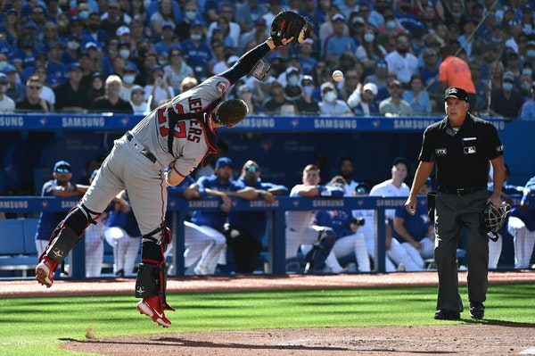 Twins catcher Ryan Jeffers missed catching a pop-up fly ball off the bat of the Blue Jays' George Springer in the first inning Saturday in Toronto.