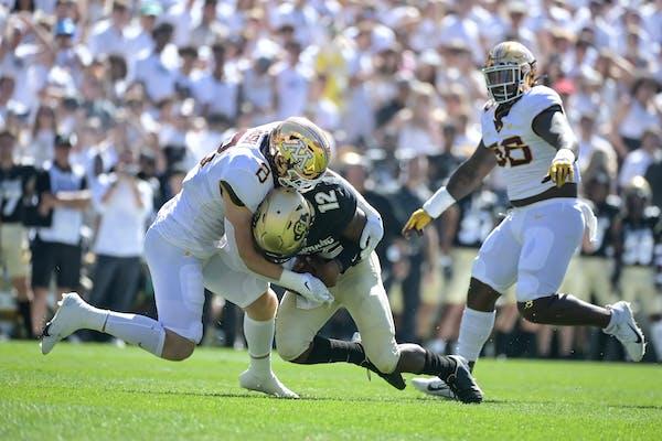Gophers defensive lineman Thomas Rush sacked Colorado quarterback Brendon Lewis in the second quarter.