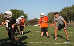 Sen. Jeremy Miller, who is stepping into the top job of Senate majority leader, coached his son's football practice in Winona Thursday. JESSIE VAN B