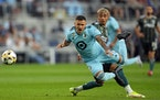 Minnesota United midfielder Franco Fragapane (7) went flying as Los Angeles Galaxy defender Julian Araujo (2) stuck his foot out to defend in the firs