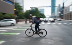 A bicyclist rode down 6th Street in Minneapolis at the end of a work day.    ]  Shari L. Gross ¥ shari.gross@startribune.com      Bike thefts have hi
