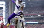 Minnesota Vikings receivers Justin Jefferson (18) and K.J. Osborn Pass (17) celebrated after a 64 yard touchdown pass to Osborn in the first quarter.