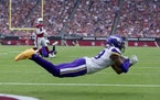 Minnesota Vikings receiver (18) Justin Jefferson caught a pass from Kirk Cousins for 14- yard touchdown in the second quarter.