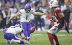 The Vikings' Greg Joseph attempts a kick in the second quarter.