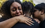"""""""he was a big brother to anybody who needed it.""""  Kaelah Foreman offers comfort to her nephew, Loyace Foreman IV, who lost his father in the killi"""