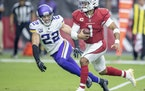 Arizona quarterback Kyler Murray drove past Vikings safety Harrison Smith for a touchdown in the second quarter.