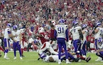 The Arizona Cardinals celebrated after Minnesota Vikings kicker Greg Joseph (1) missed a 37-yard field goal attempt on the final play of the game Sund