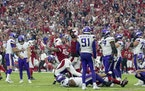 The Arizona Cardinals celebrated after Minnesota Vikings kicker Greg Joseph (1) missed a 37-yard field goal attempt on the final play of the game.