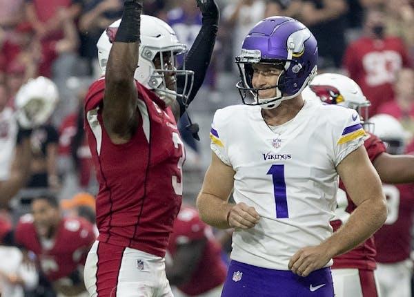 Budda Baker (3) of the Arizona Cardinals celebrated after Minnesota Vikings kicker Greg Joseph (1) reacted after missing a 37-yard field goal attempt