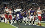 Baltimore Ravens quarterback Lamar Jackson scores a touchdown in the second half and does a flip after reaching the end zone.