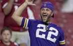 A Vikings fan cheering during a happier moment of Sunday's game in Arizona. But is that an L for loser sign he's flashing? A sign of what's to c