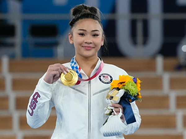 Gold medallist Sunisa Lee of the Unites States displays her medal for the artistic gymnastics women's all-around at the 2020 Summer Olympics, Thursd