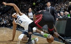 Karl-Anthony Towns of the Wolves and Miami's Chris Silva fought for the ball during an NBA game on Oct. 27, 2019 at Target Center. Silva signed with