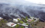 In this image made from video provided by OVERON, lava is seen after a volcanic eruption in La Palma, Spain, Monday, Sept. 20, 2021. Giant rivers of l