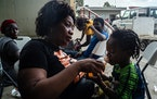 Claire Bazille, who has returned to uncertain prospects in Haiti, and her son after arriving at the airport in Port-au-Prince on Sunday, Sept. 19, 202