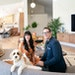 Heather and Brad Fox with Ivy, their Australian Labradoodle puppy, in the great room of their remodeled Edina home. Behind them is the kitchen.