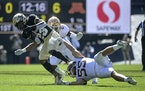 Gophers linebacker Mariano Sori-Marin (55) tackled Colorado running back Jarek Broussard on Saturday
