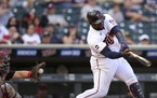 Minnesota Twins' Miguel Sano (22) strikes out against the Cleveland Indians during the seventh inning of the first baseball game of a doubleheader Tue