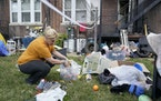 Kristen Bigogno gathers up some of her belongings while being evicted from her home Friday, Sept. 17, 2021, in St. Louis.