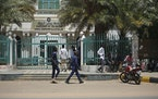 Sudanese soldiers walk in front of the office of the Sudanese Council of Ministers, in Khartoum, Sudan, Tuesday, Sept. 21, 2021.