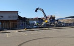 Crews started tearing down Midway Shopping Center in St. Paul on Tuesday.