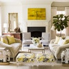 Designer Lauren Liess paired Benjamin Moore's Swiss Coffee on walls with Seashell for trim in a Washington living room.