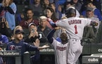 The Twins' Nick Gordon reached the dugout to celebrate with manager Rocco Baldelli (left) and Miguel Sano after Gordon's two-run homer off Cubs st