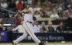 San Francisco Giants' LaMonte Wade Jr. watches his RBI-single hit during the ninth inning.