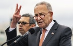 Senate Majority Leader Chuck Schumer, D-N.Y., speaks to immigrants and their supporters near the U.S. Capitol, Tuesday, Sep. 21, 2021, in Washington.