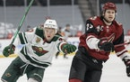 Kirill Kaprizov (97) of the Minnesota Wild and Oliver Ekman Larsson (23) of the Arizona Coyotes chased the puck in the first period.