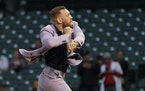 MMA fighter Conor McGregor throws out a ceremonial first pitch before a baseball game between the Chicago Cubs and the Minnesota Twins Tuesday, Sept.