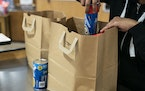 FILE-A five-cent bag fee is set to resume Oct. 1 in Minneapolis.