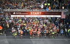 Runners head out at the start of the 2015 Twin Cities Marathon in Minneapolis. (AP Photo/Craig Lassig)