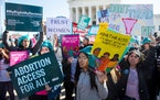 Abortion rights activists supporting legal access to abortion protest outside the U.S. Supreme Court in Washington, D.C., in March 2020.
